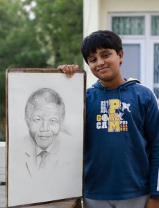 Uday Sahai with his sketch of Nelson Mandela